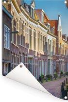 Gezellige straat in de Nederlandse stad Haarlem Tuinposter 40x60 cm - klein - Tuindoek / Buitencanvas / Schilderijen voor buiten (tuin decoratie)