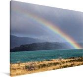 Een regenboog boven het Pehoe meer Canvas 180x120 cm - Foto print op Canvas schilderij (Wanddecoratie woonkamer / slaapkamer) XXL / Groot formaat!