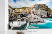 Fotobehang vinyl - Heldere blauwe zee bij Cinque Terre in Italië breedte 600 cm x hoogte 400 cm - Foto print op behang (in 7 formaten beschikbaar)