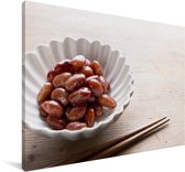 Nierbonen in een wit schaaltje met eetstokjes Canvas 180x120 cm - Foto print op Canvas schilderij (Wanddecoratie woonkamer / slaapkamer) XXL / Groot formaat!