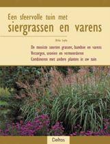 Een sfeervolle tuin met siergrassen en varens