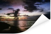 Wolken boven de zee bij het eiland Sipadan in Azië Poster 90x60 cm - Foto print op Poster (wanddecoratie woonkamer / slaapkamer)