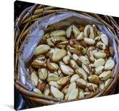 Paranoten in een rieten mand op de markt Canvas 140x90 cm - Foto print op Canvas schilderij (Wanddecoratie woonkamer / slaapkamer)