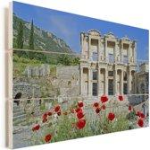 Bloemen voor de bibliotheek van Celsus in Turkije Vurenhout met planken 90x60 cm - Foto print op Hout (Wanddecoratie)