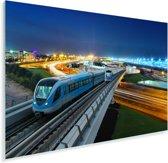 Een sporweg met een trein tijdens de nacht Plexiglas 90x60 cm - Foto print op Glas (Plexiglas wanddecoratie)