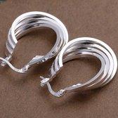 Trendy zilver oorringen twisted 4 rings
