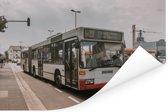 Een morderne Duitse stadsbus Poster 120x80 cm - Foto print op Poster (wanddecoratie woonkamer / slaapkamer)