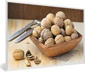 Foto in lijst - Houten kommetje vol met bruine walnoten fotolijst wit 60x40 cm - Poster in lijst (Wanddecoratie woonkamer / slaapkamer)