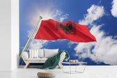 Fotobehang vinyl - Vlag van Albanië met blauwe lucht breedte 420 cm x hoogte 280 cm - Foto print op behang (in 7 formaten beschikbaar)