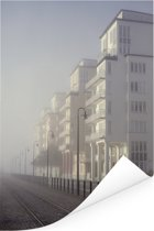 Uitzicht vanaf een spoorweg op de witte gebouwen Poster 120x180 cm - Foto print op Poster (wanddecoratie woonkamer / slaapkamer) XXL / Groot formaat!