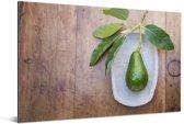 Verse avocado op een plaat Aluminium 180x120 cm - Foto print op Aluminium (metaal wanddecoratie) XXL / Groot formaat!