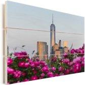 Roze bloemen voor het World Trade Center in New York Vurenhout met planken 160x120 cm - Foto print op Hout (Wanddecoratie) XXL / Groot formaat!