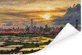 De skyline van Hongkong met op de voorgrond mooie rijstvelden Poster 120x80 cm - Foto print op Poster (wanddecoratie woonkamer / slaapkamer)