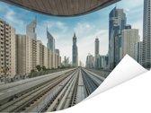 Uitzicht vanaf een spoorweg op de stad Dubai Poster 80x60 cm - Foto print op Poster (wanddecoratie woonkamer / slaapkamer)