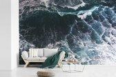 Fotobehang vinyl - Luchtfoto van golven breedte 600 cm x hoogte 400 cm - Foto print op behang (in 7 formaten beschikbaar)