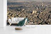 Fotobehang vinyl - Skyline van het dichtbevolkte Damascus in Syrië breedte 605 cm x hoogte 340 cm - Foto print op behang (in 7 formaten beschikbaar)