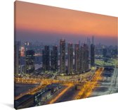 Skyline van Abu Dhabi in Azië bij een kleurrijke zonsondergang Canvas 120x80 cm - Foto print op Canvas schilderij (Wanddecoratie woonkamer / slaapkamer)