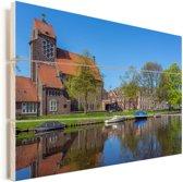 Zonnige dag in het Nederlandse Haarlem Vurenhout met planken 90x60 cm - Foto print op Hout (Wanddecoratie)