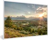 Foto in lijst - De felle zon achter het Tetongebergte in de Verenigde staten fotolijst wit 60x40 cm - Poster in lijst (Wanddecoratie woonkamer / slaapkamer)