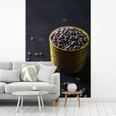 Fotobehang vinyl - Mosterdzaad in een koperen container breedte 335 cm x hoogte 500 cm - Foto print op behang (in 7 formaten beschikbaar)