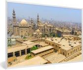 Foto in lijst - Felle zon schijnt over de gebouwen in de Egyptische stad Caïro fotolijst wit 60x40 cm - Poster in lijst (Wanddecoratie woonkamer / slaapkamer)