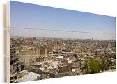 Uitzicht over een groot deel van de stad Bagdad in Irak Vurenhout met planken 80x40 cm - Foto print op Hout (Wanddecoratie)