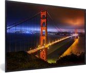 Foto in lijst - De Golden Gate Bridge in de nacht verlicht fotolijst zwart 60x40 cm - Poster in lijst (Wanddecoratie woonkamer / slaapkamer)