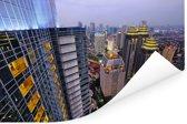 Foto van Jakarta vanaf een hoog gebouw Poster 180x120 cm - Foto print op Poster (wanddecoratie woonkamer / slaapkamer) XXL / Groot formaat!