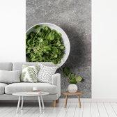 Fotobehang vinyl - Een kom tuinkers tegen een grijze achtergrond breedte 180 cm x hoogte 270 cm - Foto print op behang (in 7 formaten beschikbaar)