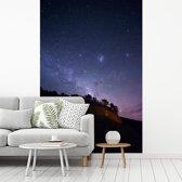 Fotobehang vinyl - Nationaal park Abel Tasman sterrenhemel breedte 215 cm x hoogte 320 cm - Foto print op behang (in 7 formaten beschikbaar)