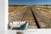Fotobehang vinyl - Een spoorweg gefotografeerd tijdens een zonnige middag breedte 420 cm x hoogte 280 cm - Foto print op behang (in 7 formaten beschikbaar)