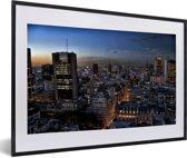 Foto in lijst - De verlichtte stad Buenos Aires in Zuid-Amerika fotolijst zwart met witte passe-partout 60x40 cm - Poster in lijst (Wanddecoratie woonkamer / slaapkamer)