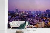Fotobehang vinyl - Paarse tinten in en boven de Chinese stad Jinan breedte 420 cm x hoogte 280 cm - Foto print op behang (in 7 formaten beschikbaar)