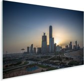 Zonsondergang achter de gebouwen in Riyad Plexiglas 90x60 cm - Foto print op Glas (Plexiglas wanddecoratie)