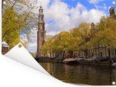 Uitzicht op een kerk vanaf de Prinsengracht in Amsterdam Tuinposter 80x60 cm - Tuindoek / Buitencanvas / Schilderijen voor buiten (tuin decoratie)