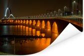 Verlichting van de Waalbrug in de Nederlandse stad Nijmegen Poster 120x80 cm - Foto print op Poster (wanddecoratie woonkamer / slaapkamer) / Europese steden Poster