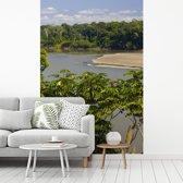 Fotobehang vinyl - Rivier tussen de groene bossen van het Nationaal park Manu in Peru breedte 240 cm x hoogte 360 cm - Foto print op behang (in 7 formaten beschikbaar)