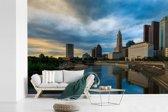 Fotobehang vinyl - Skyline van Columbus in Ohio tijdens avondschemering breedte 450 cm x hoogte 300 cm - Foto print op behang (in 7 formaten beschikbaar)