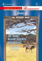 At The Rancher's Bidding (Mills & Boon American Romance)