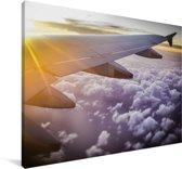 Zonnestralen langs een vliegtuig Canvas 90x60 cm - Foto print op Canvas schilderij (Wanddecoratie woonkamer / slaapkamer)
