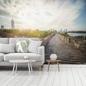 Fotobehang vinyl - Zonsopkomst achter de Chinese miljoenenstad Nanjing breedte 375 cm x hoogte 280 cm - Foto print op behang (in 7 formaten beschikbaar)