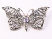 Opengewerkte zilveren vlinder broche met amethist en marcasiet