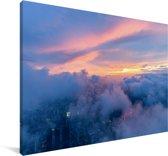 Kleurrijke lucht boven een wolkenbed Canvas 60x40 cm - Foto print op Canvas schilderij (Wanddecoratie woonkamer / slaapkamer)