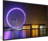 Foto in lijst - Paars gekleurde London Eye in Engeland fotolijst zwart 60x40 cm - Poster in lijst (Wanddecoratie woonkamer / slaapkamer)