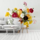 Fotobehang vinyl - Boeket van kleurrijke boterbloemen op een lichte achtergrond breedte 350 cm x hoogte 260 cm - Foto print op behang (in 7 formaten beschikbaar)