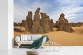 Fotobehang vinyl - Indrukwekkend gesteente in het Nationaal park Tassil n'Ajjer breedte 360 cm x hoogte 240 cm - Foto print op behang (in 7 formaten beschikbaar)