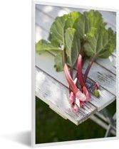 Foto in lijst - Roze rabarber op een houten tafel fotolijst wit 40x60 cm - Poster in lijst (Wanddecoratie woonkamer / slaapkamer)
