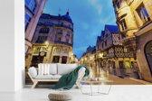 Fotobehang vinyl - Verlichting in de straten van de Franse stad Dijon breedte 420 cm x hoogte 280 cm - Foto print op behang (in 7 formaten beschikbaar)