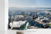 Fotobehang vinyl - Uitzicht op de moderne Japanse stad Fukuoka breedte 360 cm x hoogte 240 cm - Foto print op behang (in 7 formaten beschikbaar)