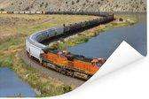 Een oranje gekleurde trein Poster 180x120 cm - Foto print op Poster (wanddecoratie woonkamer / slaapkamer) XXL / Groot formaat!